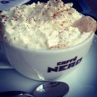 Photo taken at Caffé Nero by Ege Ş. on 3/30/2012