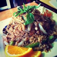 Photo taken at Thai Café Restaurant by Vicki T. on 7/12/2012