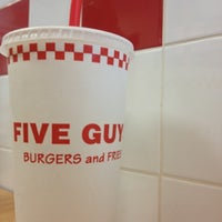 Photo taken at Five Guys by Justine O. on 5/7/2012