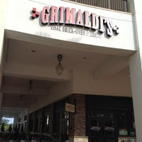 Photo taken at Grimaldi's Pizzeria by Kim R. on 5/17/2012