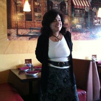 Photo taken at Strings Italian Cafe by Kevin K. on 6/5/2012