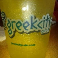 Photo taken at Greek City Cafe by Marianne S. on 2/29/2012