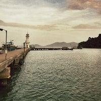 Photo taken at Bang Bao Lighthouse by warasit a. on 6/17/2012