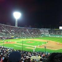 Photo taken at Sajik Baseball Stadium by JY on 4/28/2012