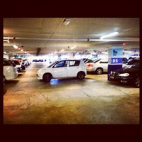 Photo taken at Queensbay Multilevel Carpark by BK H. on 5/30/2012
