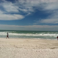 Photo taken at Coquina Beach by Charissa D. on 2/20/2012