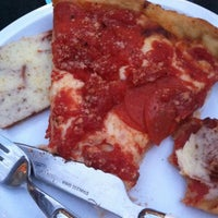 Photo taken at Lou Malnati's Pizzeria by Sarah H. on 8/14/2012
