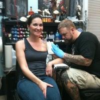 Photo taken at Black Hive Tattoo by Kat L. on 3/21/2012