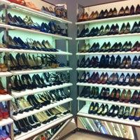 Photo taken at Shoestock by Lana R. on 7/23/2012