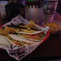 Photo taken at Tijuana Flats by Damian C. on 3/13/2012