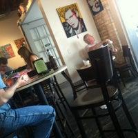 Photo taken at Halcyon Coffee, Bar & Lounge by Daniel on 3/28/2012