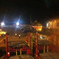 Photo taken at Gate 6 - Aeropuerto El Dorado by Santiago C. on 7/14/2012