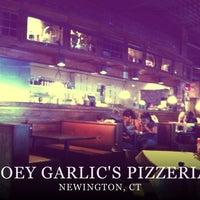 Photo taken at Joey Garlic's by Cinda M. on 6/10/2012