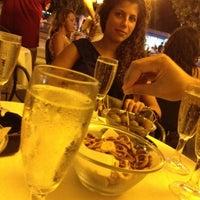 Photo taken at Spiaggia al porto by Salvatore O. on 7/28/2012