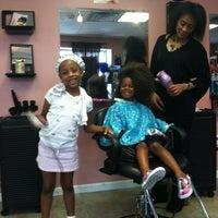 Photo taken at Urban Rose Boutique & Salon by Ellen B. on 5/5/2012
