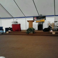Photo taken at tent revival by Daisy M. on 6/10/2012