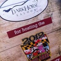 Photo taken at Dark Horse Saloon by Scott W. on 8/4/2012