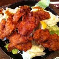 Photo taken at 肉屋鶏男 by たけお on 7/20/2012