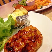 Photo taken at Sizzler by Tuk T. on 4/13/2012