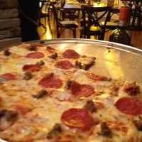 Photo taken at Zaffiro's Pizzeria & Bar by Kim L. on 9/2/2012
