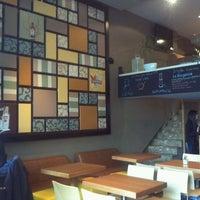 Photo taken at Indigo Cafe by Pavlos E. on 3/18/2012