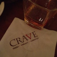 Photo taken at CRAVE American Kitchen & Sushi Bar by TheSocial360 .. on 2/18/2012