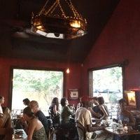 Photo taken at Justine's Brasserie by Amy K. on 8/4/2012