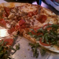 Photo taken at Mangia Pizza by Ashley C. on 2/20/2012