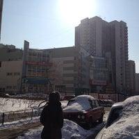 Photo taken at ТЦ «Миг» by John S. on 3/16/2012
