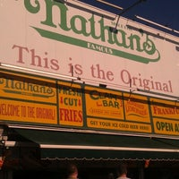 Photo taken at Nathan's Famous by Larisa S. on 9/9/2012