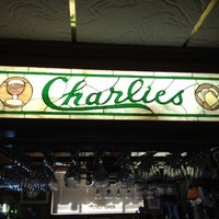 Photo taken at Charlie's Bar & Restaurant by Eric K. on 7/25/2012