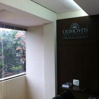 Photo taken at Olimóveis Empreendimentos Imobiliários by Auber C. on 6/30/2012