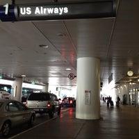 Photo taken at Terminal 1 by Rick B. on 7/27/2012