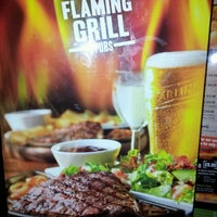 Photo taken at Friar Tuck Flaming Grill by Robert T. on 4/14/2012