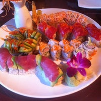 Photo taken at Sushi Monster by Ruben R. on 7/15/2012