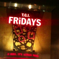 Photo taken at TGI Fridays by Erica W. on 8/17/2012
