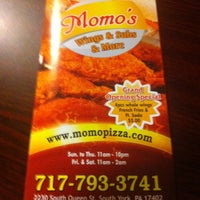 Photo taken at Momo's Pizza&wings by Tom R. on 6/12/2012