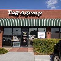 Photo taken at Greenway Plaza Tag Agency by April A. on 8/3/2012