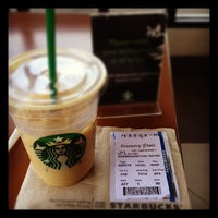 Photo taken at Starbucks by tyas r. on 7/10/2012