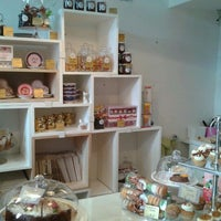 Photo taken at MoMade Cupcakes by Melissa B. on 4/1/2012