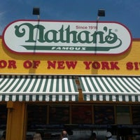 Photo taken at Nathan's Famous by Megan T. on 8/6/2012