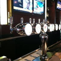 Photo taken at BJ's Restaurant and Brewhouse by Ross A. on 2/10/2012