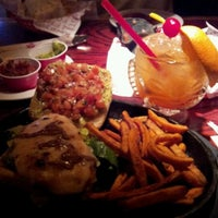 Photo taken at Red Robin Gourmet Burgers by Greg S. on 4/24/2012