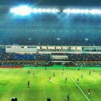 Photo taken at Stadion Utama Riau by Ricky R. on 7/13/2012