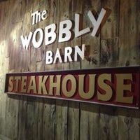 Photo taken at Wobbly Barn Steakhouse by John W. on 2/19/2012