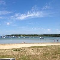 Photo taken at Fish Creek Beach by Jack N. on 7/30/2012