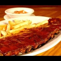 Photo taken at Outback Steakhouse by Wagner ldj C. on 4/9/2012