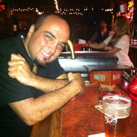 Photo taken at Pineapple Hill Saloon & Grill by Gaelle N. on 5/20/2012
