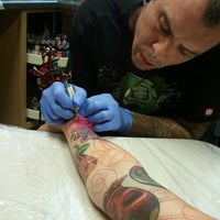 Photo taken at House Of Pain Tattoo by Ms. Carolyn E. on 4/16/2012