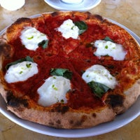 Photo taken at Olio Wood Fired Pizzeria by Laura B. on 5/13/2012